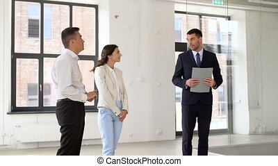 realtor showing new office room to customers - real estate...