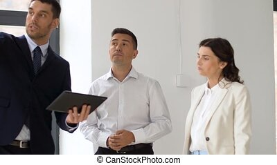 realtor showing office to customers with tablet pc - real...