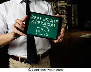 Realtor shows Real estate appraisal on his tablet.