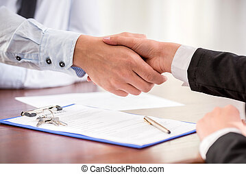 Realtor - Handshake of a real estate agent and a client.