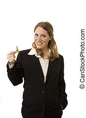Realtor - Female realtor on white background holding a key
