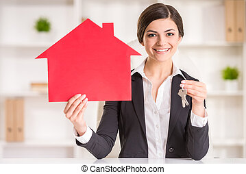 Realtor - Happy realtor woman is showing home for sale sign...