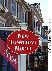 New Townhome Model - Realty Sign advertising New Townhome...