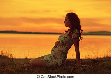 Realxed woman looking at the sunset