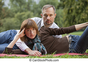realxing couple on grass