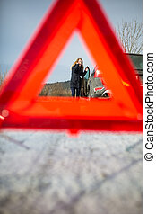 Realy angry young woman in a road distress situation -...