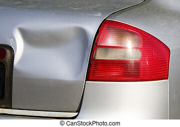 Rear of silver car get damaged by crash accident on the road. Car repair or car insurance concept