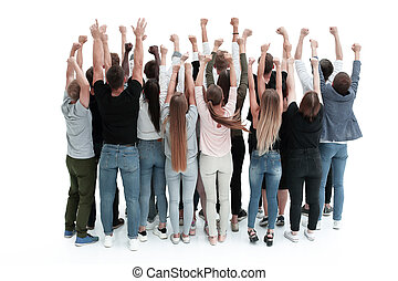 rear view. an ambitious group of young people with hands up