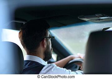 rear view. business man sitting in a modern car