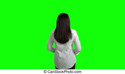 Rear view business woman in white shirt stretching himself against green screen