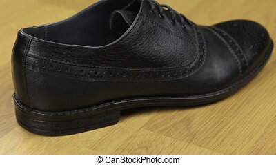 Rear view, classic men's leather shoes with laces. Slider shot. Fashion background