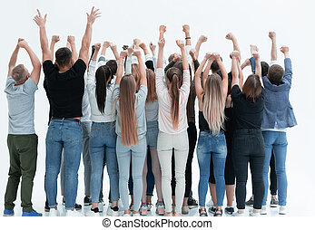 group of diverse young people standing with hands up