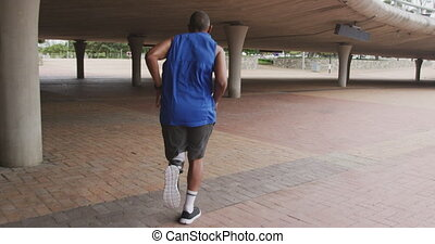 Rear view man with prosthetic leg running - Rear view of a ...