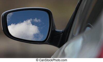 Rear view mirror reflecting sky - Looking Car rear-view...