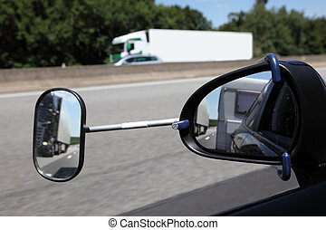Rear view mirror with extension for driving with a trailer
