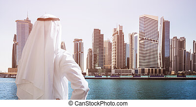 Man Standing In Front Of Dubai Business Bay