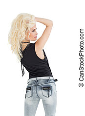 Rear view of a beautiful casual blond posing