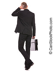 Rear view of a business man thinking