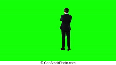 Rear view of a business man waiting with green screen - Rear...