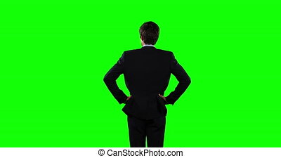 Rear view of a business man with green screen