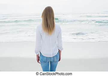 Rear view of a casual blond at beach