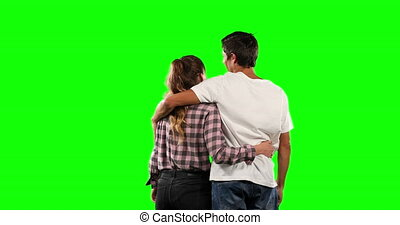 Rear view of a couple with green screen