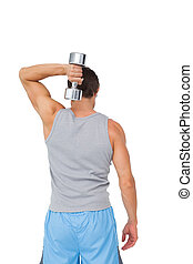 Rear view of a man exercising with dumbbell