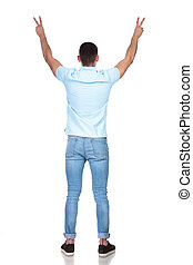 rear view of a man raising his hands as a sign of peace and welcoming in a studio with white background