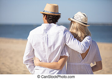 rear view of a romantic couple on the beach