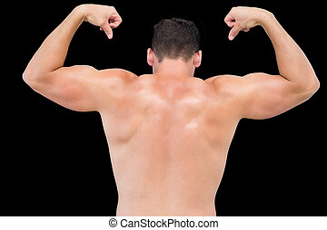 Rear view of a shirtless muscular man flexing muscles