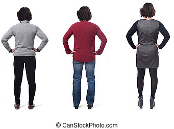 rear view of a woman dressed sporty casual and dress, hands on hip