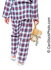 Rear view of a woman in pajamas carrying a toy. Hips in the frame