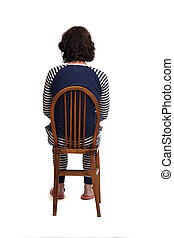rear view of a woman in pajamas sitting o a chair on white backgraund,