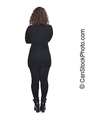 rear view of a woman on white arms crossed