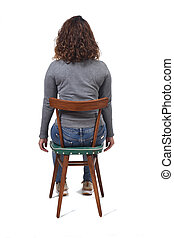 rear view of a woman sitting on chair on white background,