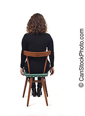 rear view of a woman sitting on chair on white background
