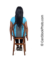 rear view of a woman sitting on her back with white background