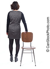 rear view of a woman with a chair in white background