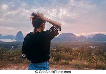 Rear view of a young woman enjoying the awesome view of Ao Phang Nga National Park