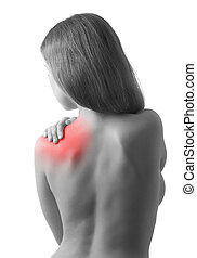 Rear view of a young woman holding her shoulder in pain, isolated on white background, monochrome photo with red as a symbol for the hardening