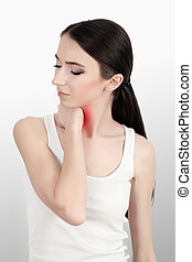 rear view of a young women holding her neck in pain. isolated on white background. monochrome photo with red as a symbol for the hardening.