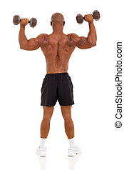 rear view of african bodybuilder training with dumbbells