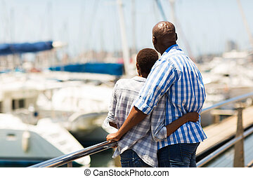 rear view of african couple at the harbour