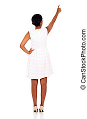 rear view of african woman pointing empty copy space