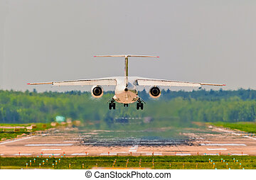 Rear view of an aircraft departing from the airport