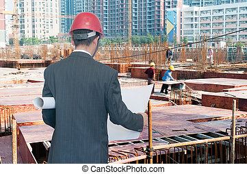 architect looking comparing housing project