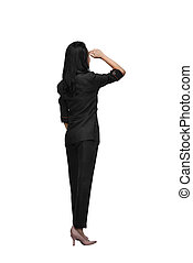 Rear view of asian business woman looking up