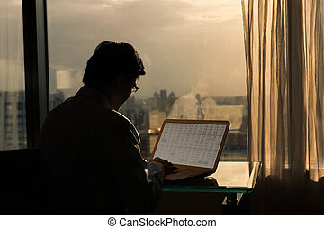 businessman working at sunset