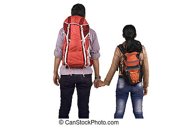 Rear view of asian couple with backpack holding hands
