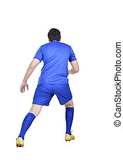Rear view of asian football player in action